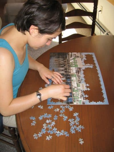 Assembling custom photo puzzle.